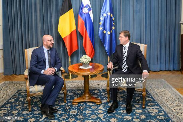 Slovenian Prime Minister Miro Cerar and his Belgian counterpart Charles Michel talk during their meeting in Ljubljana Slovenia on May 5 2017 / AFP...