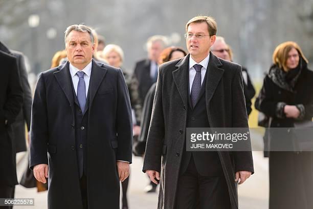 Slovenian Prime Minister Miro Cerar and Hungarian Prime Minister Viktor Orban walk during their meeting in Brdo, near Kranj, on January 22, 2016. /...