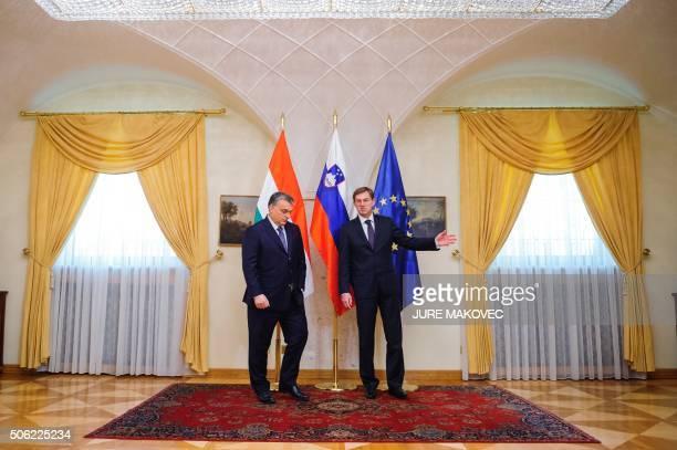 Slovenian Prime Minister Miro Cerar welcomes his Hungarian counterpart Viktor Orban during their meeting in Brdo, near Kranj on January 22, 2016. /...