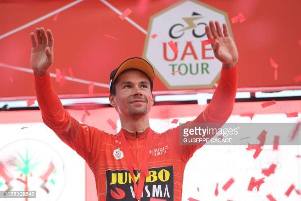 Slovenian Primoz Roglic of team JumboVisma celebrates on the podium the red jersey at the end of the fifth stage of the UAE tour in Khor Fakkan on...