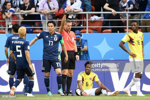 TOPSHOT Slovenian referee Damir Skomina shows a red card to Colombia's midfielder Carlos Sanchez for handling the ball during the Russia 2018 World...