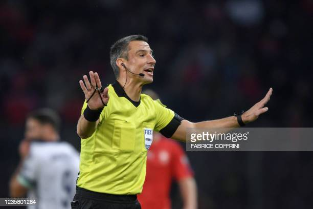 Slovenian referee Slavko Vincic gestures during FIFA World Cup Qatar 2022 qualification football match between Switzerland and Northern Ireland at...