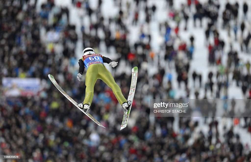 Slovenian ski jumper Jaka Hvala soars through the air during his qualification jump at the 61th edition of the Four-Hills-Tournament (Vierschanzentournee) on December 31, 2012 in Garmisch-Partenkirchen, southern Germany. The second competition of the jumping event will take place in Garmisch-Partenkirchen, before the tournament continues in Innsbruck (Austria) and in Bischofshofen (Austria).