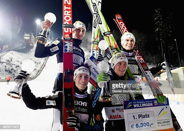 Slovenian ski jumpers Jurij Tepes Nejc Dezman Jernej Damjan and Peter Prevc pose after their victory in the Large Hill Team competition on day two of...
