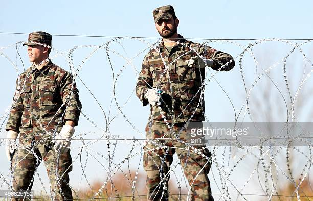 Slovenian soldiers set up barbed wire fences on the SlovenianCroatian border in Sela pri Dobovi near Brezice on Novemberr 11 2015 Slovenia on...
