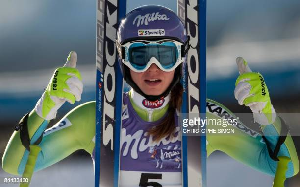 Slovenian Tina Maza gestures after taking the fourth place of the women's World Cup downhill event on January 24, 2008 in Cortina. Swiss Dominique...