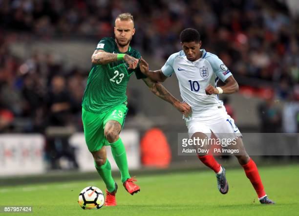 Slovenia's Aljaz Struna and England's Marcus Rashford battle for the ball during the 2018 FIFA World Cup Qualifying Group F match at Wembley Stadium...