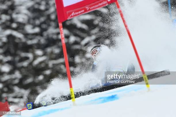 Slovenia's Ana Bucik falls as she competes in the first run of the Women's Giant Slalom event during the FIS Alpine ski World Cup in Lenzerheide, on...