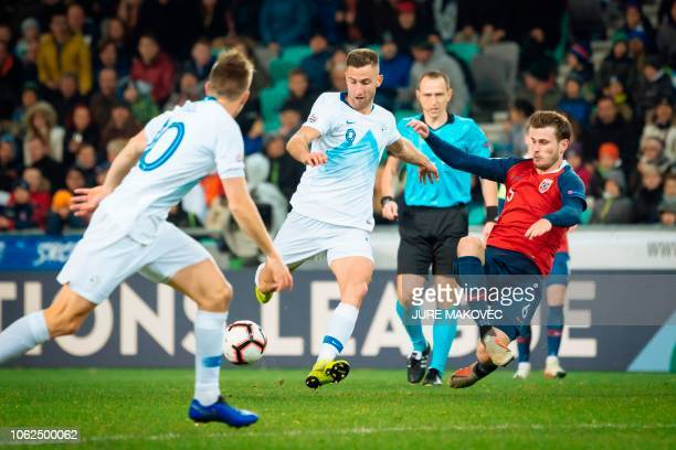 Slovenia's Andraz Sporar vies for the ball with Havard Nordtveit of Norway during a UEFA Nations League football match Slovenia against Norway at...