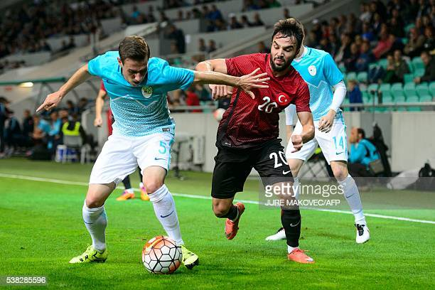 Slovenia's Boban Jovic and Turkey's Volkan Sen vie for the ball during the friendly football match Turkey versus Slovenia at the Stadium Stozice in...