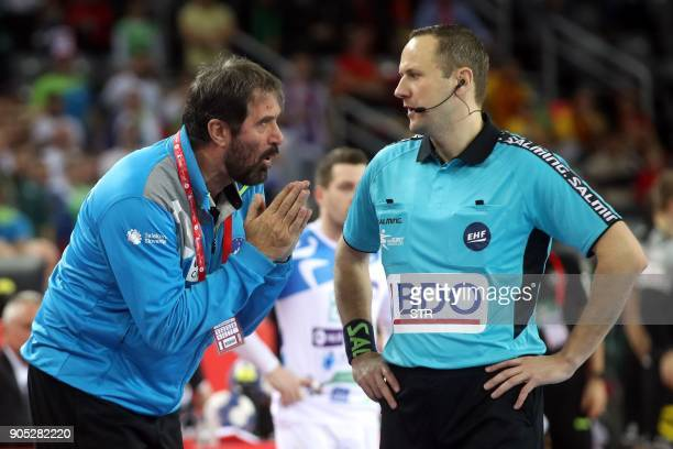 Slovenia's coach Veselin Vujovic gestures as he speaks with the referre during the group C handball match of the Men's 2018 EHF European Handball...