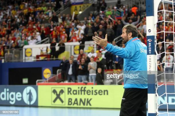 Slovenia's coach Veselin Vujovic gestures as he stands in front of the goal to try to save last penalty protesting against the referee decision to...