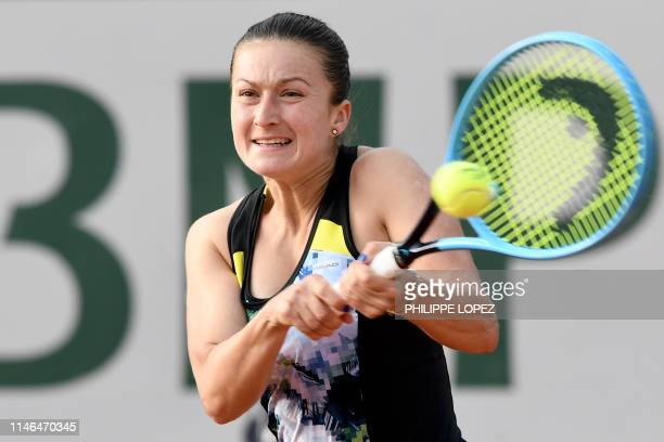Slovenia's Dalila Jakupovic plays a backhand return to Japan's Kurumi Nara during their women's singles first round match on day two of The Roland...