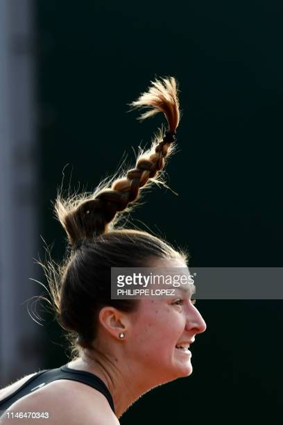 Slovenia's Dalila Jakupovic reacts as she plays against Japan's Kurumi Nara during their women's singles first round match on day two of The Roland...