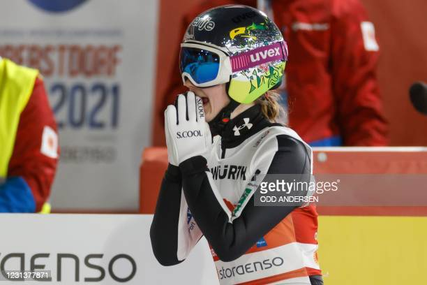Slovenia's Ema Klinec reacts after the second jump of the women's HS106 ski jumping event at the FIS Nordic Ski World Championships in Oberstdorf,...