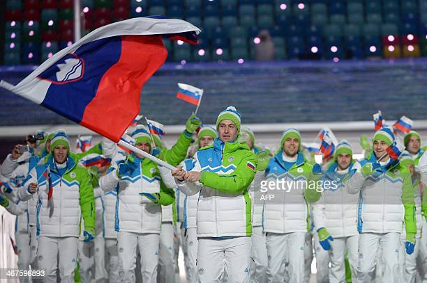 Slovenia's flag bearer ice hockey player Tomaz Razingar leads his national delegation during the Opening Ceremony of the Sochi Winter Olympics at the...