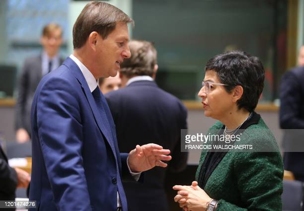 Slovenia's Foreign Minister Miro Cerar and Spain's Foreign Minister Arancha Gonzalez Laya talk during an European foreign affairs council in Brussels...