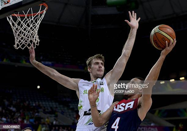 Slovenia's forward Zoran Dragic vies with US guard Stephen Curry during the 2014 FIBA World basketball championships quarterfinal match Slovenia vs...