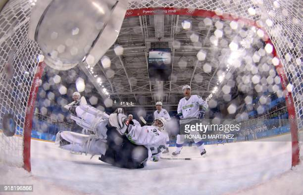 Slovenia's Gasper Kroselj looks on after a goal is scored in the men's preliminary round ice hockey match between the US and Slovenia during the...