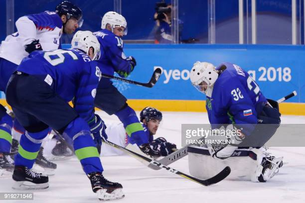 Slovenia's Gasper Kroselj stops a shot on goal in the men's preliminary round ice hockey match between Slovakia and Slovenia during the Pyeongchang...