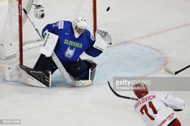Slovenia's goalkeeper Gasper Kroselj fails to stop a goal during the IIHF Men's World Championship group B ice hockey match between Slovenia and...