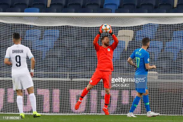 Slovenia's goalkeeper Jan Oblak catches the ball during the Euro 2020 Group G football qualification match between Israel and Slovenia in at the...
