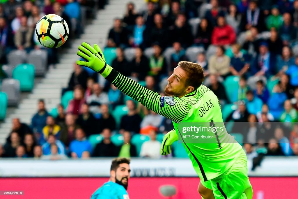 Slovenia's goalkeeper Jan Oblak goes for the save during the FIFA World Cup 2018 qualifier football match between Slovenia and Scotland at the Stozice stadium in Ljubljana, on October 8, 2017. / AFP PHOTO / Jure Makovec