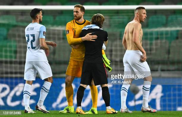 Slovenia's goalkeeper Jan Oblak greets Croatia's Luka Modric at the end of the FIFA World Cup Qatar 2022 Group H qualification football match between...