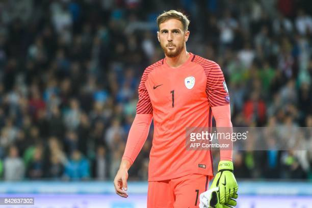 Slovenia's goalkeeper Jan Oblak looks on after his team won the FIFA World Cup 2018 qualification football match between Slovenia and Lithuania at...