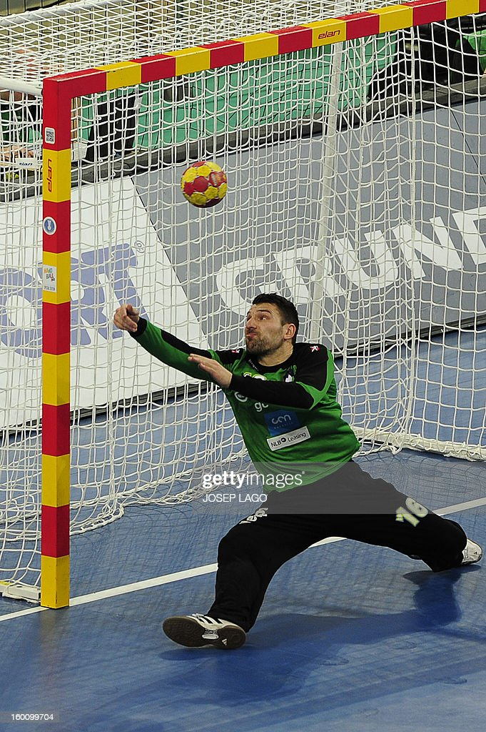 Slovenia's goalkeeper Primoz Prost misses to save a goal during the 23rd Men's Handball World Championships bronze medal match Slovenia vs Croatia at the Palau Sant Jordi in Barcelona on January 26, 2013.