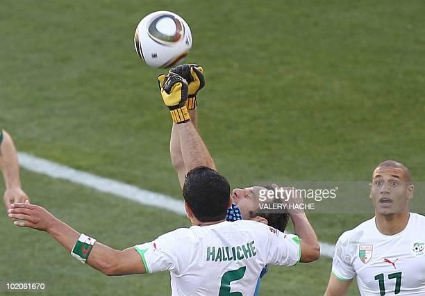 Slovenia's goalkeeper Samir Handanovic deflects the ball as Algeria's defender Rafik Halliche and Algeria's midfielder Adlane Guedioura look on...