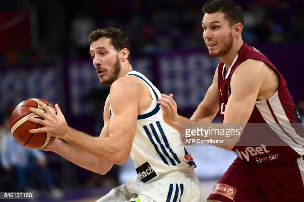 Slovenia`s Goran Dragic fights for the ball with Latvia`s guard Dairis Bertans during FIBA Eurobasket 2017 men`s quarter final basketball match...