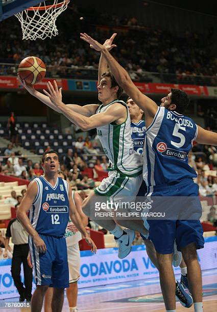 Slovenia's Goran Dragic shoots against Greece's Ioannis Bourousis during a quarterfinal match of the European Basketball Championships in Madrid 14...