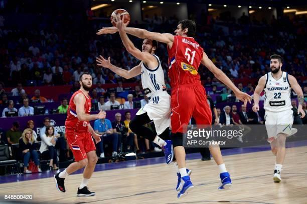 Slovenia's guard Goran Drgic goes to basket next to Serbia's forward Milan Macvan and Boban Marjanovic during the FIBA Eurobasket 2017 men's Final...