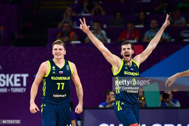 Slovenia's guard Luka Doncic and Goran Dragic celebrate after scoring during the FIBA Eurobasket 2017 men's semifinal basketball match between Spain...
