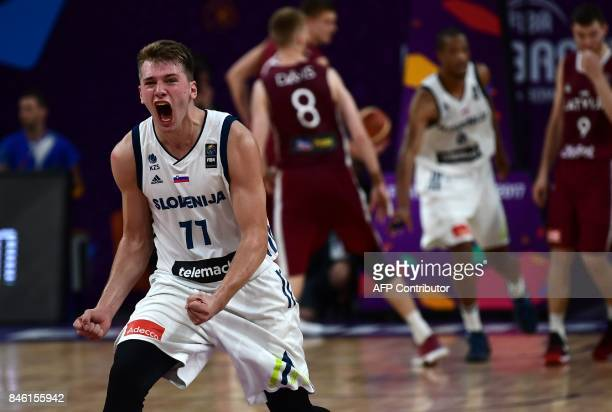 TOPSHOT Slovenias guard Luka Doncic celebrates after victory against Latvia during FIBA Eurobasket 2017 men`s quarterfinal basketball match between...