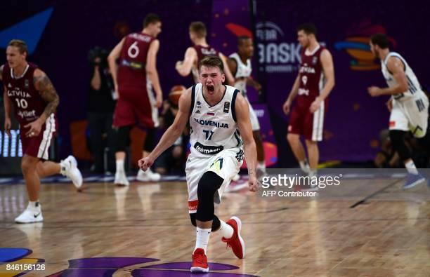 Slovenias guard Luka Doncic celebrates after victory against Latvia during FIBA Eurobasket 2017 men`s quarterfinal basketball match between Slovenia...