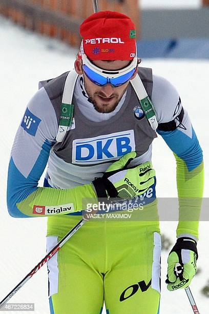 Slovenia's Jakov Fak reacts as he crosses the finish line to win the men's 15 km mass start event of the IBU Biathlon Word Cup in the Siberian city...