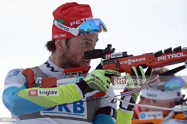 Slovenia's Jakov Fak shoots during the men's 15 km mass start event of the IBU Biathlon Word Cup in the Siberian city of KhantyMansiysk on March 22...