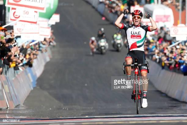 Slovenia's Jan Polanc of team UAE Emirates celebrates as he crosses the finish line to win the 4th stage of the 100th Giro d'Italia Tour of Italy...
