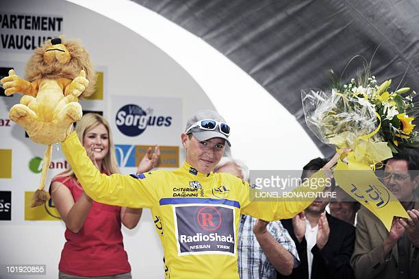 Slovenia's Janez Brajkovic is seen on the podium on June 9 2010 in Sorgues after the 49 km time trial stage run between Monteux and Sorgues southern...