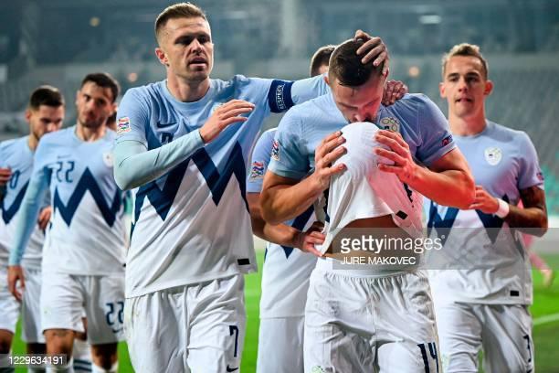 Slovenia's Jasmin Kurtic and Slovenia's Josip Ilicic celebrate after scoring a goal during the UEFA Nations League football match between Slovenia...
