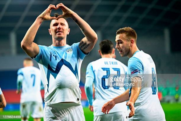 Slovenia's Jasmin Kurtic celebrates after scoring a goal during the UEFA Nations League football match between Slovenia and Kosovo at the Stadium...
