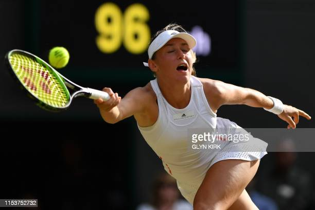 Slovenia's Kaja Juvan returns against US player Serena Williams during their women's singles second round match on the fourth day of the 2019...