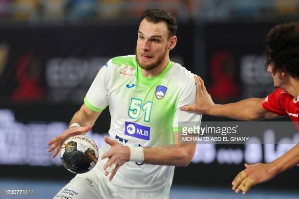 Slovenia's left back Borut Mackovsek is challenged by Egypt's left back Ali Mohamed Zein during the 2021 World Men's Handball Championship match...