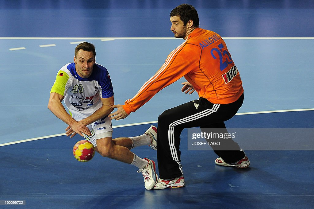 Slovenia's left wing Luka Zvizej (L) shoots past Croatia's goalkeeper Mirko Alilovic during the 23rd Men's Handball World Championships bronze medal match Slovenia vs Croatia at the Palau Sant Jordi in Barcelona on January 26, 2013.