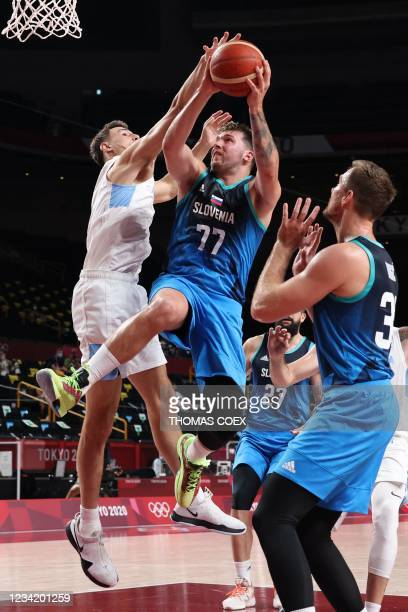 Slovenia's Luka Doncic goes to the basket in the men's preliminary round group C basketball match between Argentina and Slovenia during the Tokyo...
