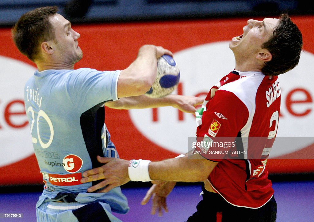 Slovenia's Luka Zvizej (L) vies for the ball with Norway's Glenn Solberg during their 8th Men's European Handball Championship Main Round match, 23 January 2008 at the Stavanger Idrettshall. Slovenia won 33-29.