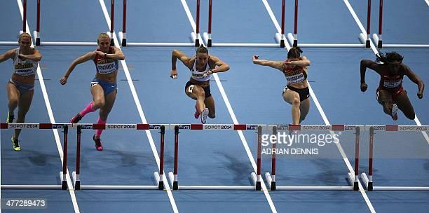 Slovenia's Marina Tomic Russia's Yuliya Kondakova France's Cindy Billaud Germany's Nadine Hildebrand and US Nia Ali compete in the Women 60 m Hurdles...