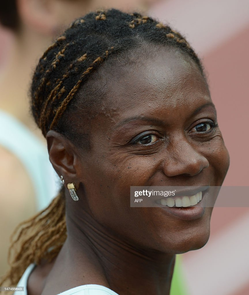 Slovenia's Marlene Ottey smiles after the women's 4x100m relay semi-finals of the 2012 European Athletics Championships at the Olympic Stadium in Helsinki on June 30, 2012.